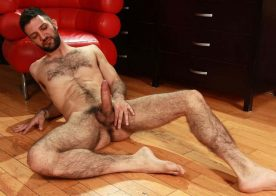 Hottie Nathan Raider jerks his big uncut cock at Butch Dixon