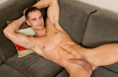 Ripped jock Evan gets naked and strokes his juicy cock for Sean Cody