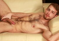 Hairy hunk Gabriel Phoenix plays with his uncut cock at UK Naked Men