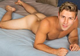 Fit blond jock Dylan strokes his uncut cock at Sean Cody