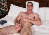 Big muscle hunk Scott Ambrose works his cock at Active Duty