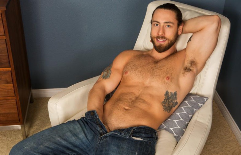 Furry muscle hunk Kenneth jerks off and shoots his load at Sean Cody