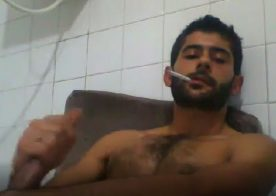 Turkish guy jerks his big cock while smoking