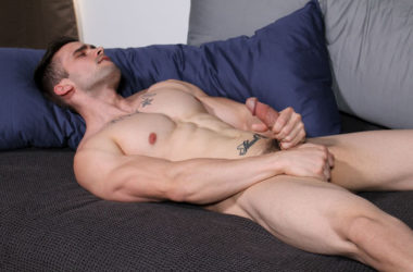 Muscular recruit Mathias plays with his big cock at Active Duty