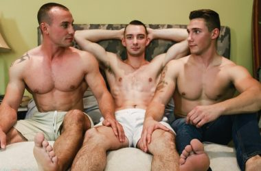 Spencer Laval and Marc Montana spit-roast Johnny B in a bareback Active Duty threesome