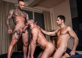 "Dylan James and Michael Lucas spit-roast Jake Morgan in ""Butt Fucked Hardcore"" (scene 4)"